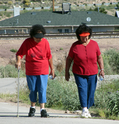 Elders in red, Leota Suminimo and Josie Powsey.